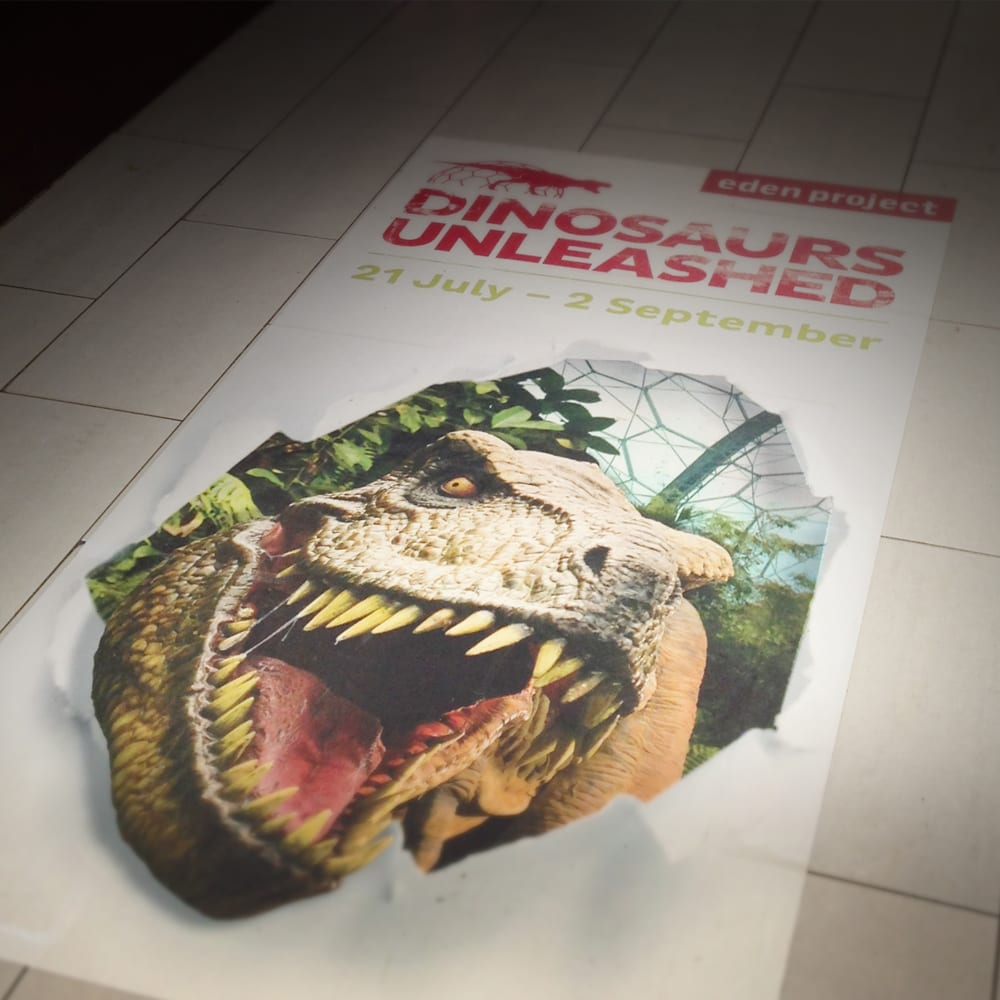 Dinosaurs unleashed advertising on service station floor