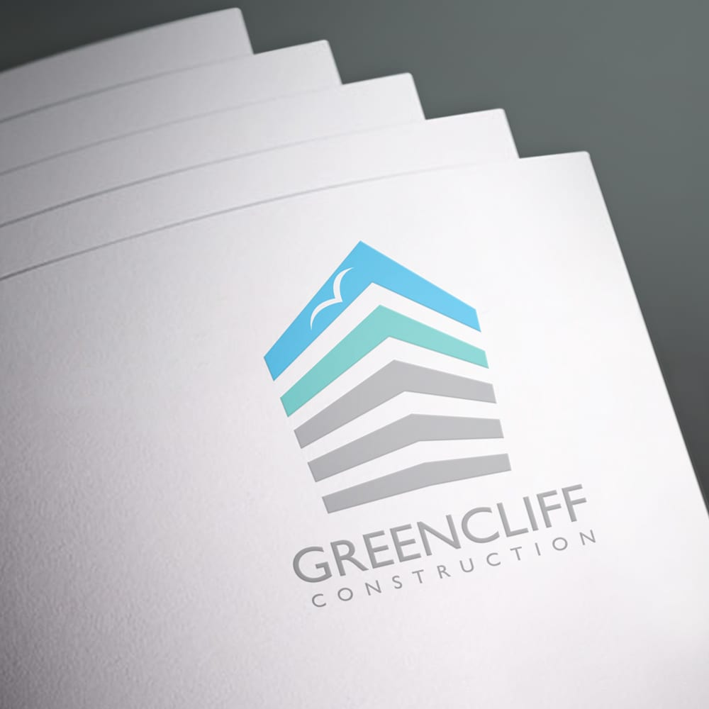 Greencliff Construction logo branding on top of a piece of paper